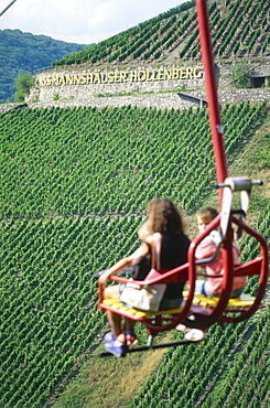 Persons in chair lift passing vineyard, Assmannshausen, Rhine District, Hesse, Germany