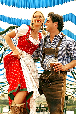 Couple dancing on table in a beer tent