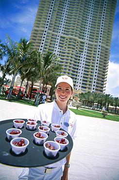 Waitress with refreshments, Hotel Acqualina Resort, Sunny Isles Beach, Miami, Florida, USA