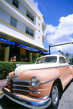 Vintage car infront of Art Deco house, Collins Avenue, South Beach, Miami, Florida, USA