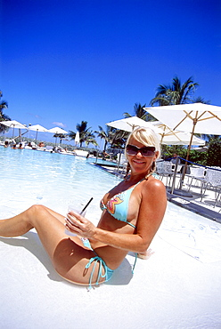Girl with cocktail at Swimming Pool, South Beach, Miami, Florida, USA