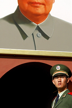 Soldier in front of Mao portrait, Beijing, China