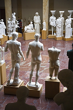 """Sculptures and visitors in the museum for """"Abguesse Klassischer Bildwerke"""", Munich, Germany"""