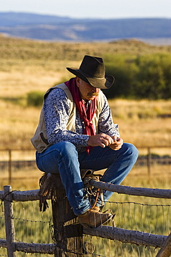 cowboy on fence, wildwest, Oregon, USA