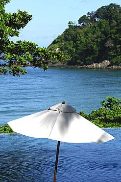 Sun shade on the pool, sea in the backround, Koh Lanta, Ko Lanta, Thailand, Asia