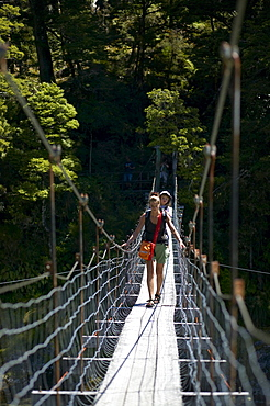 Mother with child on hanging bridge, track to Blue Pools, east of Haast Pass, Southern Alps, South Island, New Zealand