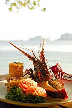 Spiny Lobster dish with sweetcorn at Beach Restaurant The Grotto and sea view, Hotel Rayavadee, Hat Phra Nang, Krabi, Thailand
