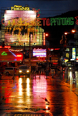 Neon lights reflecting on the wet road of Soi Bangla, Patong, Phuket, Thailand