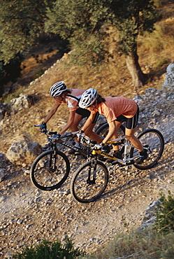Two people mountainbiking, on a mountain bike tour, near Soller, Mallorca, Balearic Islands, Spain