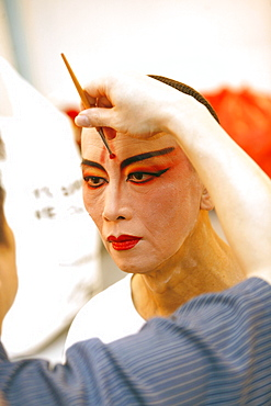 Man in mask, Chinese Opera at the Kreta Ayer Theatre, Chinatown, Singapore