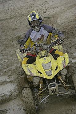 Man driving Suzuki Quad through mud, Test Grounds, Suzuki Offroad Camp, Valencia, Spain