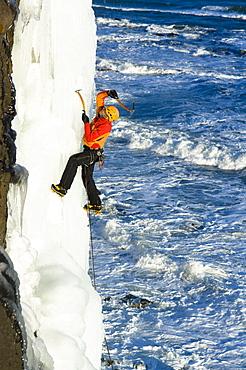 Ice climber at coast, Iceland