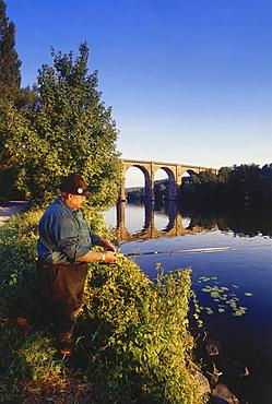 Angler fishing, Railway viaduct in the background, Herdecke, Ruhr Valley, Ruhr, Northrhine Westphalia, Germany