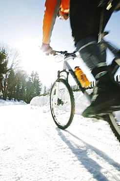 Mountain biker in snow, Styria, Austria