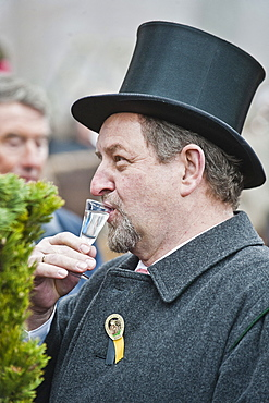 Man drinking schnaps, Leonhardi Procession, Bad Toelz, Upper Bavaria, Bavaria, Germany