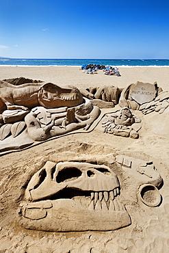 Dinosaur sand sculpture in the sunlight, Playa de Las Canteras, Las Palmas, Gran Canaria, Canary Islands, Spain, Europe