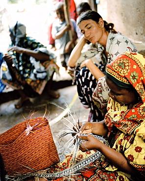 Traditional Ukili Plaiting, date palm leaves get braid into bags, craftwork project Moto, cooperative near Kisomanga (Uroa), east coast, Zanzibar, Tanzania, East Africa
