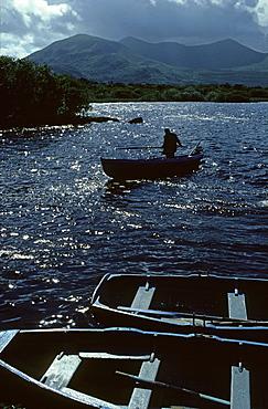 Fisherman on Lough Leane, Killarney National Park, County Kerry, Ireland, Europe