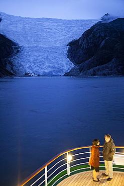 Couple on deck of cruise ship MS Deutschland, Reederei Peter Deilmann, near terminal of Italian Glacier, Chilean fjords, Magallanes y de la Antartica Chilena, Patagonia, Chile, South America