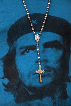 Cross hanging from the neck of man wearing a blue Che Guevara T-shirt, Havana, Havana, Cuba, Caribbean