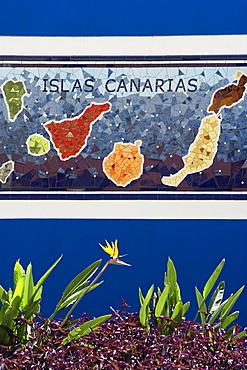Strelitzia in front of a mosaic of the Canary Islands, Puerto de la Cruz, Tenerife, Canary Islands, Spain, Europe