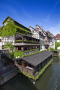 Restaurant Au Pont St. Martin and half timbered houses along the canal in La Petite France district, Strasbourg, Alsace, France, Europe