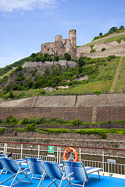 View of Rhine river cruise ship MS Bellevue and Burg Ehrenfels castle, Rudesheim am Rhein, Hesse, Germany, Europe
