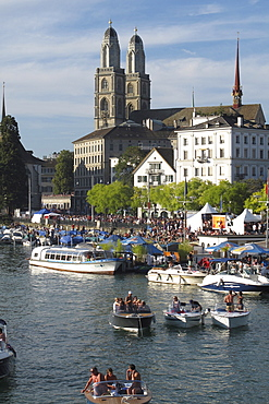 Boats at the Limmat River with the Great Minster in the background, Zurich, Switzerland