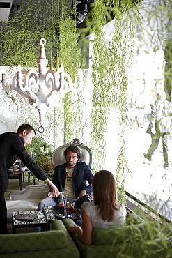 Couple inside hotel's on-site restaurant, Brussels, Belgium