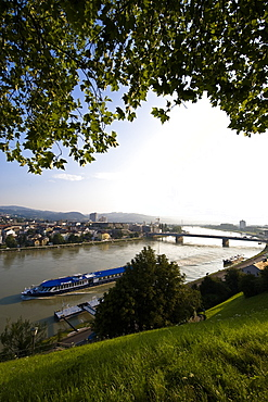 View from Schlossberg at the Danube with excursion boat and Nibelungen bridge, Linz, Upper Austria, Austria