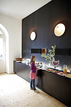 Girl in a hotel breakfast room, Fincken, Mecklenburg-Western Pomerania, Germany