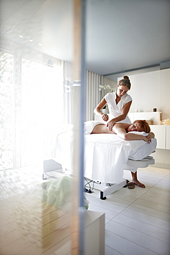 Woman enjoying back massage in a spa hotel, Ramatuelle, Provence-Alpes-Cote d Azur, France