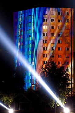 Beam of light and high rise building at night, Linz, Upper Austria, Austria .