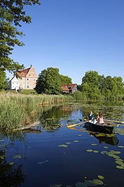 Two women in a rowing boat on lake Ulrichshusen, Ulrichshusen castle, Mecklenburg-West Pomerania, Germany