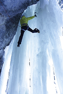 Iceclimber climbing on an ice face, Immenstadt, Bavaria, Germany