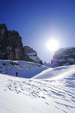Woman backcountry skiing, looking towards Gamsfreiheit, Grosser Turm and Drusenfluh, Drei Tuerme, Raetikon, Montafon, Vorarlberg, Austria