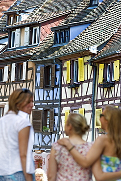 Woman and daughters in Petite Venise, Colmar, Alsace, France