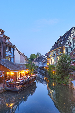 Restaurant and half timbered houses at the Lauch river in the evening, Little Venice, Colmar, Alsace, France, Europe