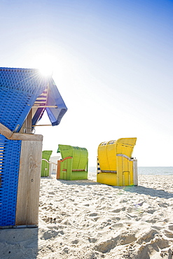 Colourful beachchairs on the beach in the sunlight, Wyk, Foehr, North Frisian Islands, Schleswig-Holstein, Germany, Europe