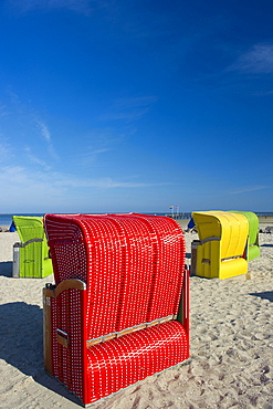 Colourful beachchairs under blue sky, Utersum, Foehr, North Frisian Islands, Schleswig-Holstein, Germany, Europe