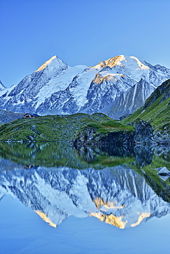 Combin de Corbassiere and Petit Combin reflecting in a mountain lake, Pennine Alps, Valais, Switzerland