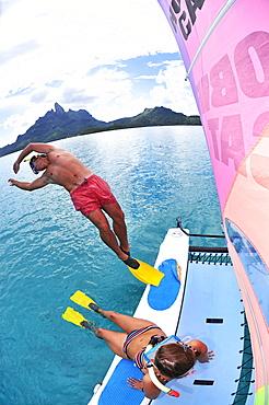 Man diving into the water to go snorkelling, Saint Regis Bora Bora Resort, Bora Bora, Society Islands, French Polynesia, Windward Islands, South Pacific