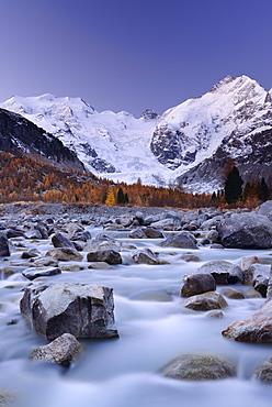 River flowing through Morteratsch valley at dawn with Bernina range in the background, Bernina range, Engadin, Grisons, Switzerland