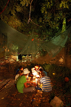 Children listening to stories about robbers in candlelight, kids programm by tour operator Vamos, Hotel Sipan, Sipanska Luka, Sipan island, Elaphiti Islands, northwest of Dubrovnik, Croatia