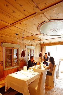 Guests having breakfast in Lagacio Hotel Mountain Residence, S. Cassiano, Alta Badia, Italy