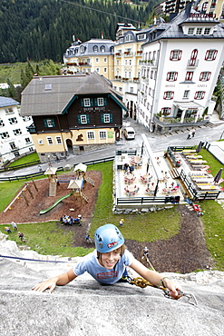 Boy on a climbing wall, centre of Bad Gastein, Salzburg, Austria