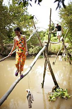 Monkey bridge crossing canal near Cao Lanh, Dong Thap, Vietnam