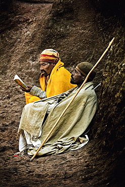 Two pilgrims sitting on rocks, Lalibela, Ethiopia, Africa