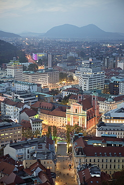 View at Franciscan church of the annunciation from castle at dusk, capital Ljubljana, Slovenia