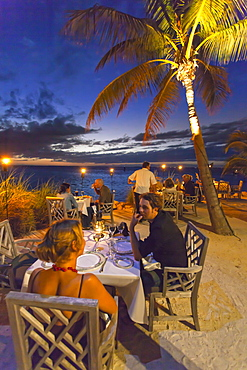 Dining couple at Restaurant DINING ROOM at sunset, Little Palm Island Resort, Florida Keys, USA